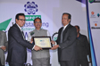 Mr Girish Matlani Receiving Award from Hon'ble Chief Minister of MP Mr Shivraj Singh Chouhan.